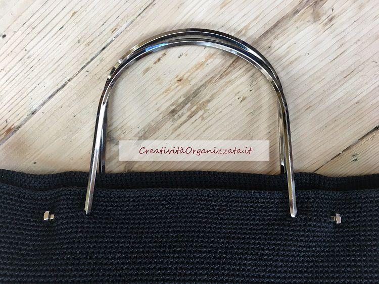 dettaglio manici borsa con fondo rigido